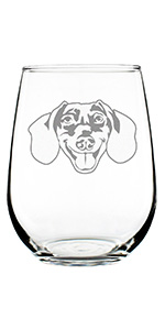 Design of a happy dachshund face, engraved on a stemless wine glass.