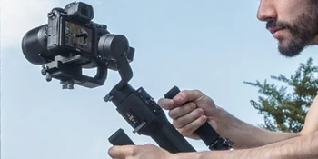 Man using the DJI Ronin-S Stabilizer with camera mounted