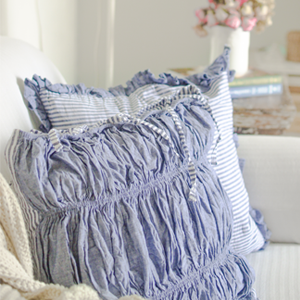 blue cotton cushion covers in sailor stripes in a set of 3 on couch