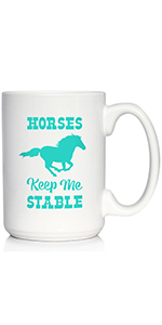 Text says Horses Keep Me Stable with design of a running horse, printed in teal ink on a coffee cup