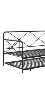 Black metal daybed and trundle with secured metal slats and geometric accents on backrest and arms.