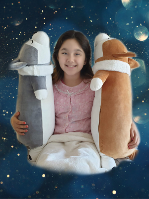 girl with 2 dog pillows