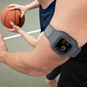 a man wears actionsleeve while playing basketball