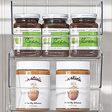 Two Clear Plastic Storage Bins with Stacked on Pantry Shelf with Almond Butter and Jelly Jam Jars