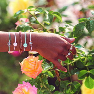hand wearing jewelry flowers