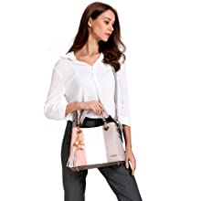 pink handbag model white background