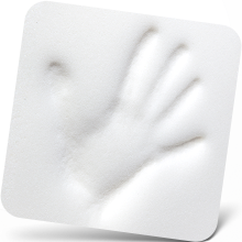 Hand indentation on white memory foam of office foot rest