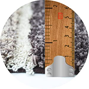 Pile height of rugs is 1 inch. These are thick soft and cozy