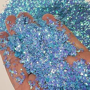 blue fluorescent glitter in hand