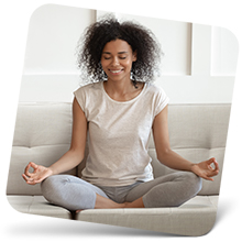 Woman meditating and breathing easier with the room humidifier