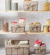 Taupe fabric lined metal storage bins organized in a pantry