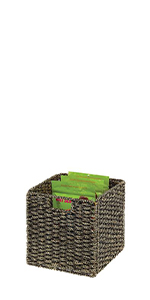 Black Seagrass Woven Kitchen Pantry Storage Basket with Handles Containing Bags of Dry Snack Food