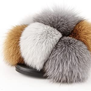 It is made of Real Fox Fur. It Is very fluffy, soft.