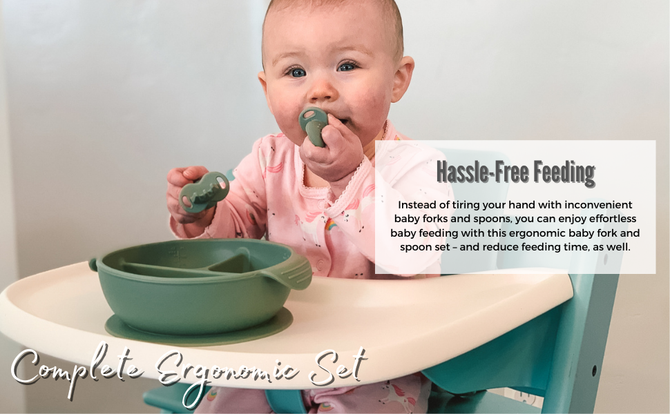 Baby girl using BabyBliss silicone feeding set during her meal.