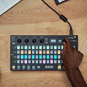 ONE HAND OTN THE AKAI PRO FIRE,BUTONS ARE LIGHT IN DIFFERENT COLORS