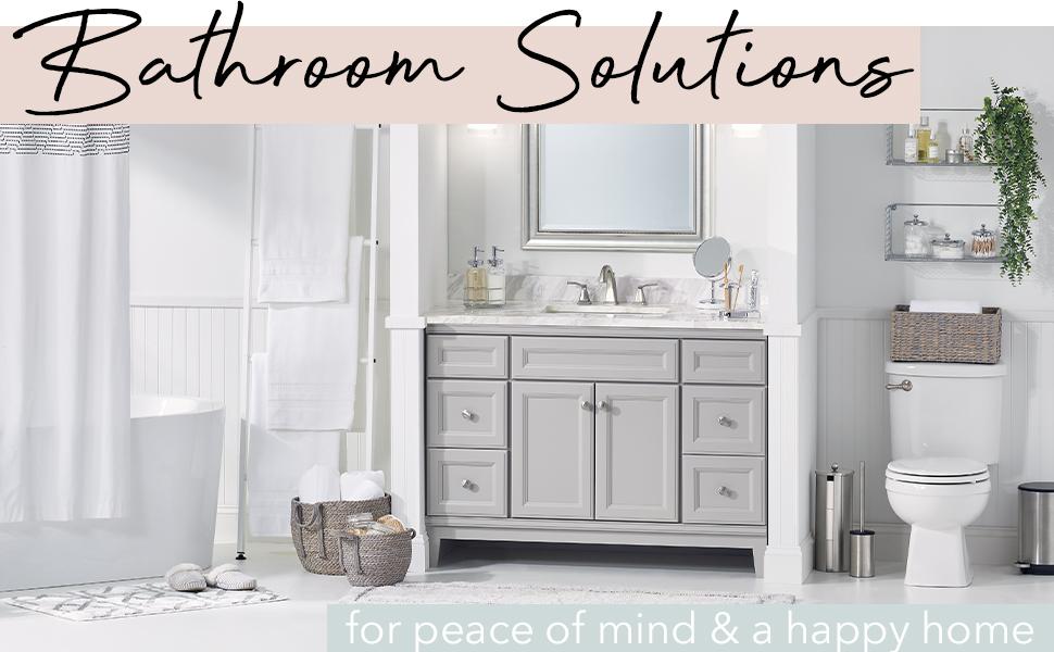 Bathroom Solutions Header, tub, towels, sink vanity, mirror and toilet in a white bathroom setting