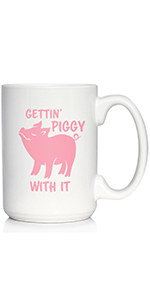 Text says Gettin Piggy With It with design of a sassy pig, printed in pink ink on a coffee cup
