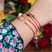 Red string bracelets