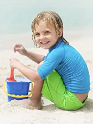 a boy on the sand beach