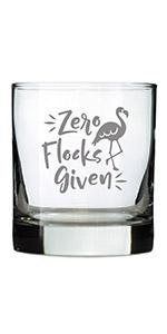 Text says Zero Flocks Given with design of a flamingo, engraved onto a rocks glass.