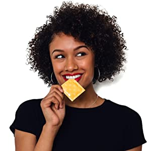 Women holding condom wrapper near her mouth