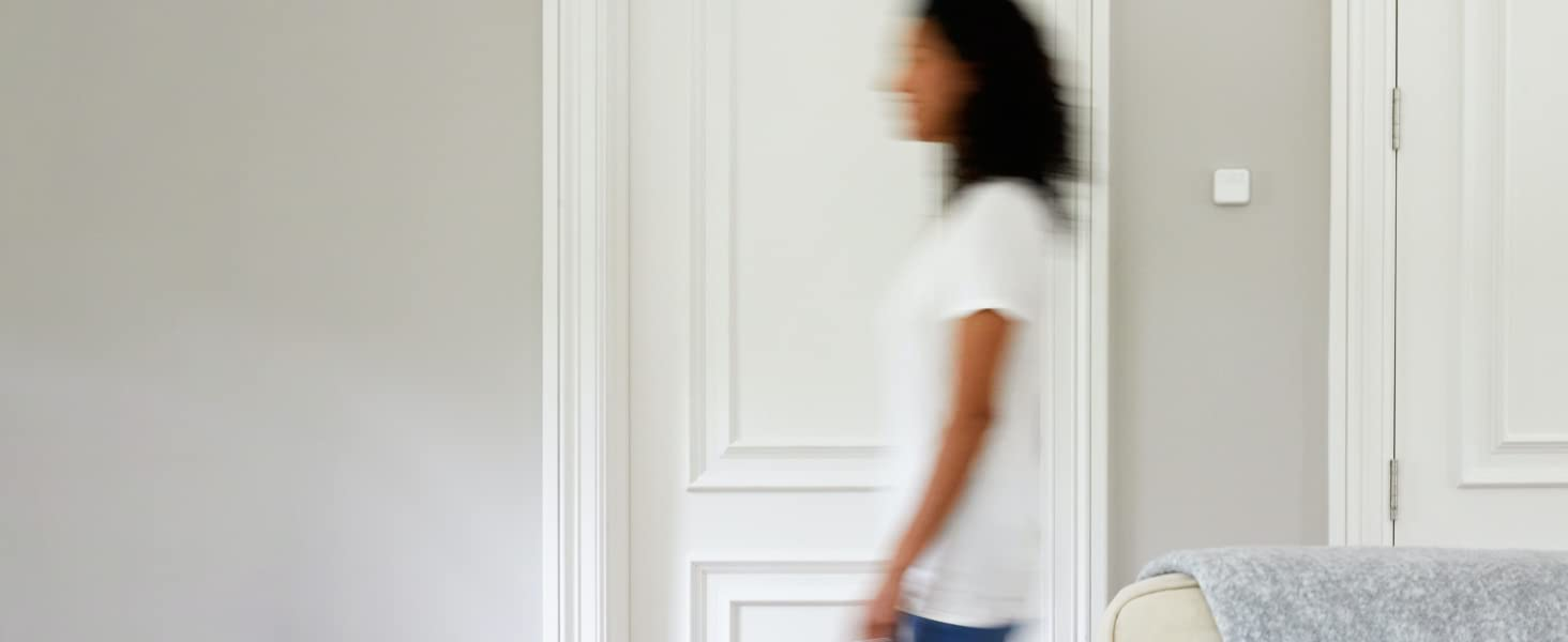 Woman walking past a Smart Room Sensor