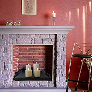 The candle holder tray place on the fireplace