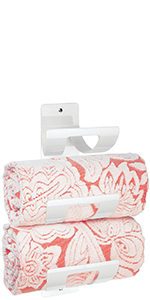 White Plastic Wall Mount Hand Towel Holder with 3 Curved Shelves Holding 2 Coral Decorative Towels