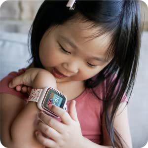 Photo of little girl playing with PlayZoom watch.