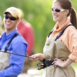 A couple took our fishing rod to go fishing, they enjoyed the fun of sports together while fishing