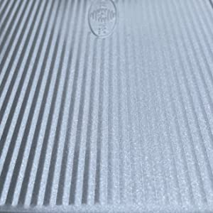 Corrugated texture for nonstick properties, heat distribution, increased air flow
