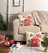 Poinsettia embroidered pillow covers on a couch