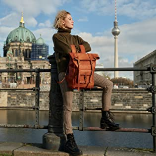 Berliner Bags Model holding our vintage Leeds M backpack in front of the TV tower