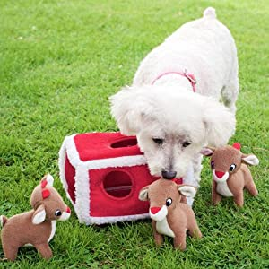 Red burrow with three reindeer and small white dog