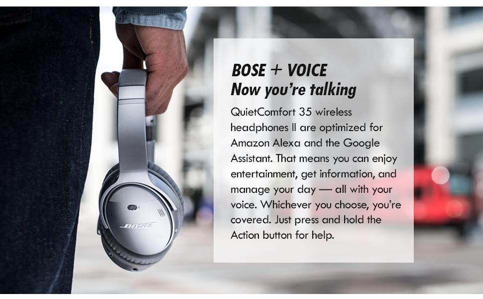 Hand holding a silver Bose QC 35 II headphones