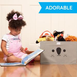 little girl with koala toy box