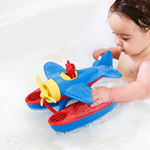 Baby in tub with a toy