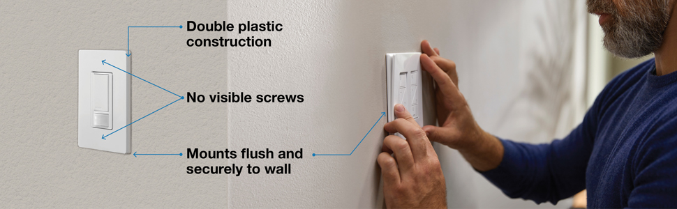 A person installing a wallplate onto a wall.