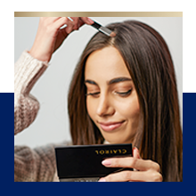 Woman applying Root Touch Up Powder
