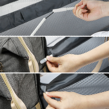 Straighten the half-folded struts,Pass the two longer struts through the holes on both sides.