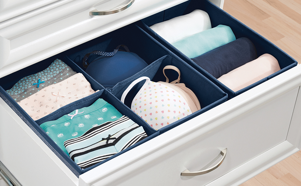 navy fabric drawer organizer holding folded under garments in a white open drawer, wood floor