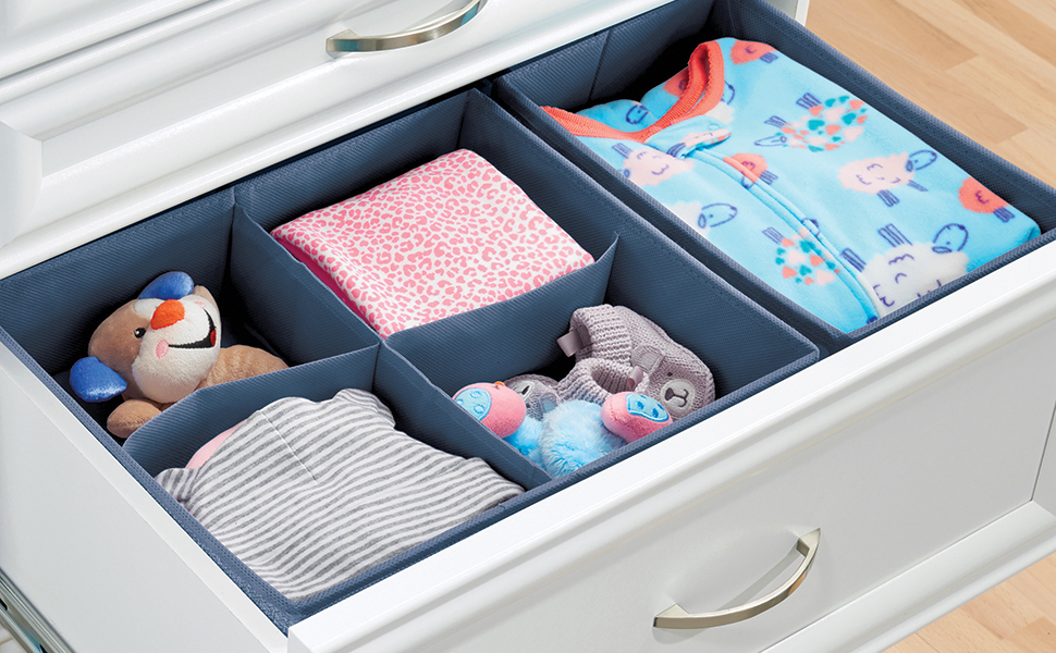 white open drawer showing blue fabric drawer dividers, baby clothes, toy, slippers, wood floor