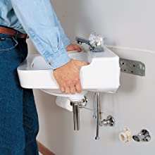 White, porcelain sink being installed.