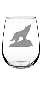 Wolf silhouette design hand engraved onto a stemless wine glass.