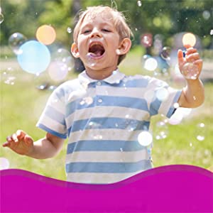 kids bubbles outdoor playing