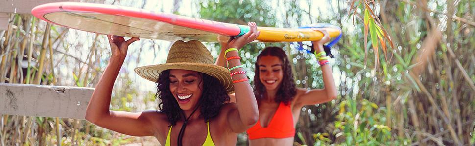 girls carrying surfboard bracelets beach summer jewelry swimsuit