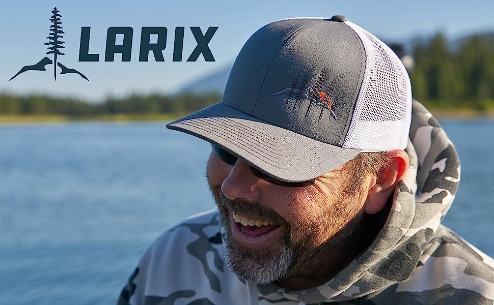 Co-Founder Zac Reid wearing a Larix Hat while fishing.
