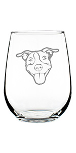 Design of a happy Pitbull face engraved onto a stemless wine glass.