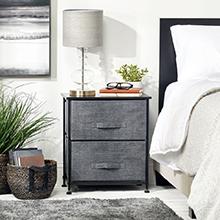 2 drawer black storage unit, gray drawers, lamp, glasses, books, bedroom setting, bed, basket, plant