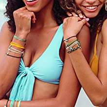 girls bracelets jewelry swimsuit beach laughing